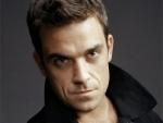 Robbie Williams Mendapat Bonus Gara-Gara Keracunan Makanan